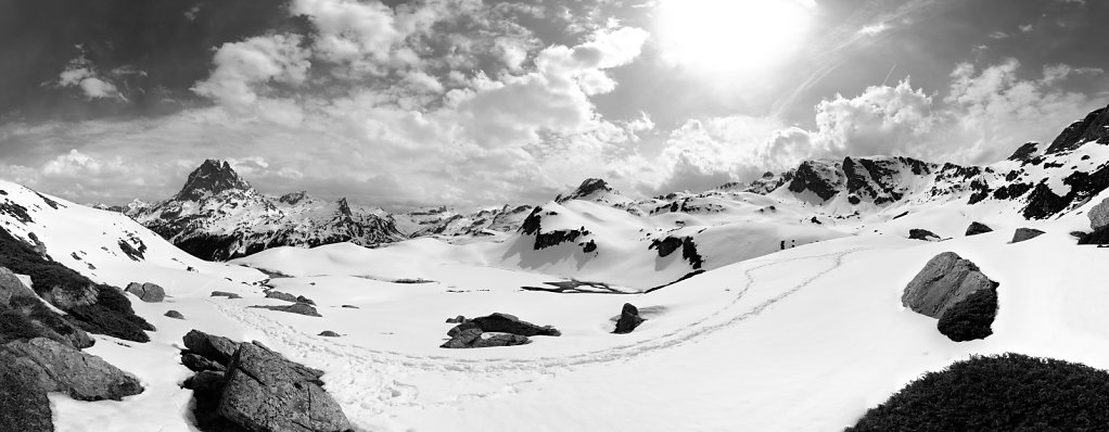 Picnic break in front of The peak of Midi d'Ossau B&W - Pyrenees, France